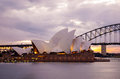 Sydney opera house and the harbour bridge at dusk australia july taken from mrs macquarie s point Royalty Free Stock Photos