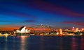 Sydney opera house and harbour bridge at sundown australia april two of s famous icons the lit up dusk after a vivid Royalty Free Stock Photography