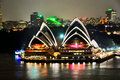 Sydney opera house illuminated at night as viewed from kirribilli Royalty Free Stock Photos