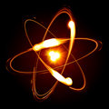 Symbol of atom over black background Royalty Free Stock Photos