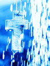 Symbol of Baptism - Cross under water shower Stock Images