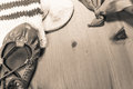 Symbol of basque holiday summer festival with scarf, abarka shoe and wool sock on wooden background in sepia Royalty Free Stock Photo