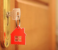 Symbol of the house and stick the key in the keyhole Royalty Free Stock Photos