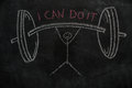 Symbol of human with barbell and I can do it text on black chalkboard