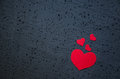 Symbol of love and valentines day background - bright red hearts on a black background. Love concept