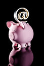 At symbol on piggy bank Stock Images