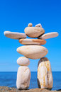 Symbolic figurine made pebbles shore Royalty Free Stock Photography