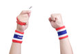 Symbolic protest eviction thailand flag wristband at the hands of men Stock Photography