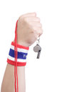 Symbolic thailand flag wristband at the hands of men Stock Photos