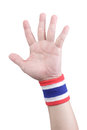 Symbolic thailand flag wristband at the hands of men Stock Photography