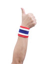 Symbolic thailand flag wristband at the hands of men Royalty Free Stock Photography