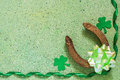 Symbols of St. Patrick's Day: horseshoe, shamrock clover, green Royalty Free Stock Photo