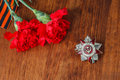 Symbols of Victory in Great Patriotic War two red flower and George ribbon Royalty Free Stock Photo