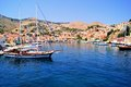 Symi harbor view of the at greece with deep blue mediterranean waters Royalty Free Stock Images