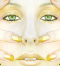 Symmetric gold face of woman Royalty Free Stock Photo