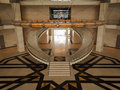Symmetric stairs of the museum of islamic art doha qatar december empty entrance foyer and circular marble staircase on december Stock Image