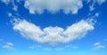 Symmetrical clouds cloudscape in a blue sky Stock Images
