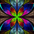 Symmetrical multicolor fractal flower in stained glass style. Co Stock Photos