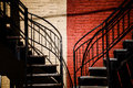 Symmetrical staircases with two different colors red and beige Stock Photography