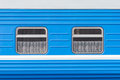 Symmetrical windows of the blue locomotive wagon.