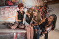 Sympathetic friends with girl afraid young women sitting in urban setting Royalty Free Stock Photos