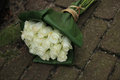 Sympathy bouquet on pavement white roses in a small the Royalty Free Stock Photo