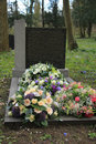Sympathy flowers on a grave multicolored an old Royalty Free Stock Images