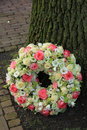 Sympathy wreath near tree a pink and white roses Royalty Free Stock Images