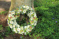 Sympathy wreath near a tree various sorts of white flowers Royalty Free Stock Images