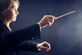 Symphony orchestra conductor music conducting hands with baton Stock Photos