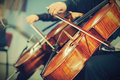 Symphony orchestra on stage hands playing cello Stock Photography