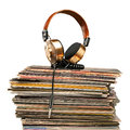 The symphony of soul golden headphones lying on stack vinyle records Royalty Free Stock Image