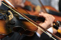 Symphony violin closeup of musician playing the during a Royalty Free Stock Photo