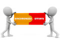 Synchronized efforts words pieces put together little d men white background concept teamwork coordination people to deliver Royalty Free Stock Images