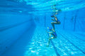 Synchronized team swimming girls underwater action at national championships kings park durban south africa Stock Photo