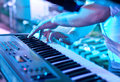 Synthesizer man playing the keyboard Royalty Free Stock Image