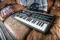 Synthesizer and mixer a keyboard a on a vintage leather couch Stock Image