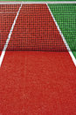 Synthetic sports field for tennis with turf markings and netting used in detail Royalty Free Stock Photography