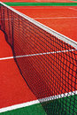 Synthetic sports field for tennis with turf markings and netting used in detail Royalty Free Stock Photos