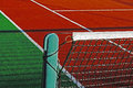 Synthetic sports field for tennis with turf markings and netting used in detail Stock Photos