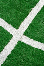 Synthetic sports field with turf and different markings used in detail Royalty Free Stock Photography