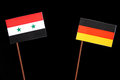 Syrian flag with German flag  on black Royalty Free Stock Photo