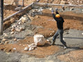 Syrian Worker in Lebanon Splitting Rocks at a Construction Site Royalty Free Stock Photo