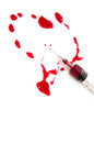 Syringe and blood heart splat red Stock Photo
