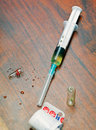 Syringe with medicine on wooden table Royalty Free Stock Photos