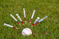 Syringes stuck in baseball Stock Photography