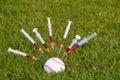 Syringes stuck in baseball Royalty Free Stock Photo