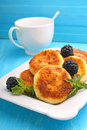 Syrniki cottage cheese pancakes fritters of cottage cheese traditional ukrainian and russian cuisine Stock Images