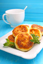 Syrniki cottage cheese pancakes fritters of cottage cheese traditional ukrainian and russian cuisine Stock Photos