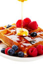 Syrup Pouring Over Waffles Royalty Free Stock Image